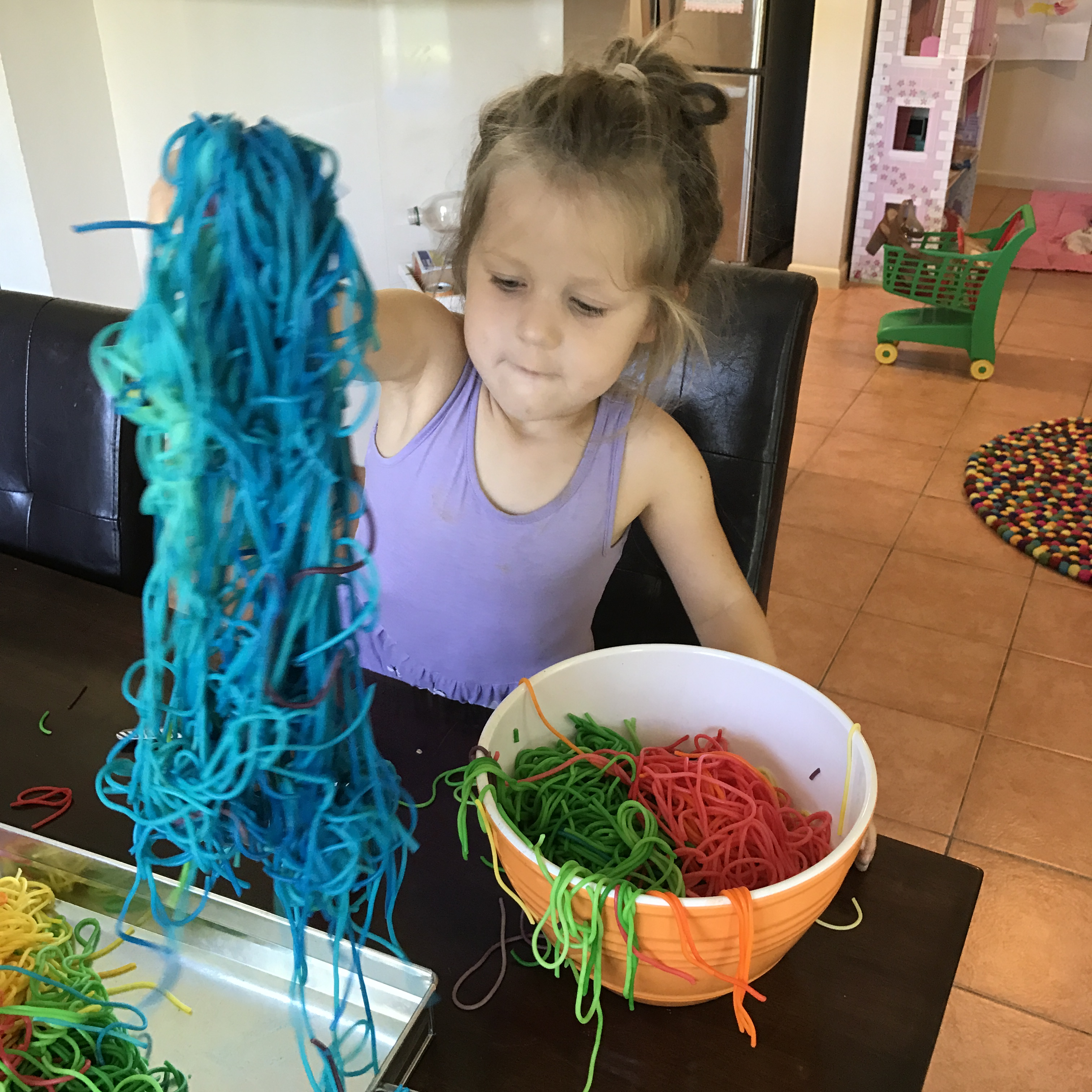 to make a rainbow spaghetti sensory bin