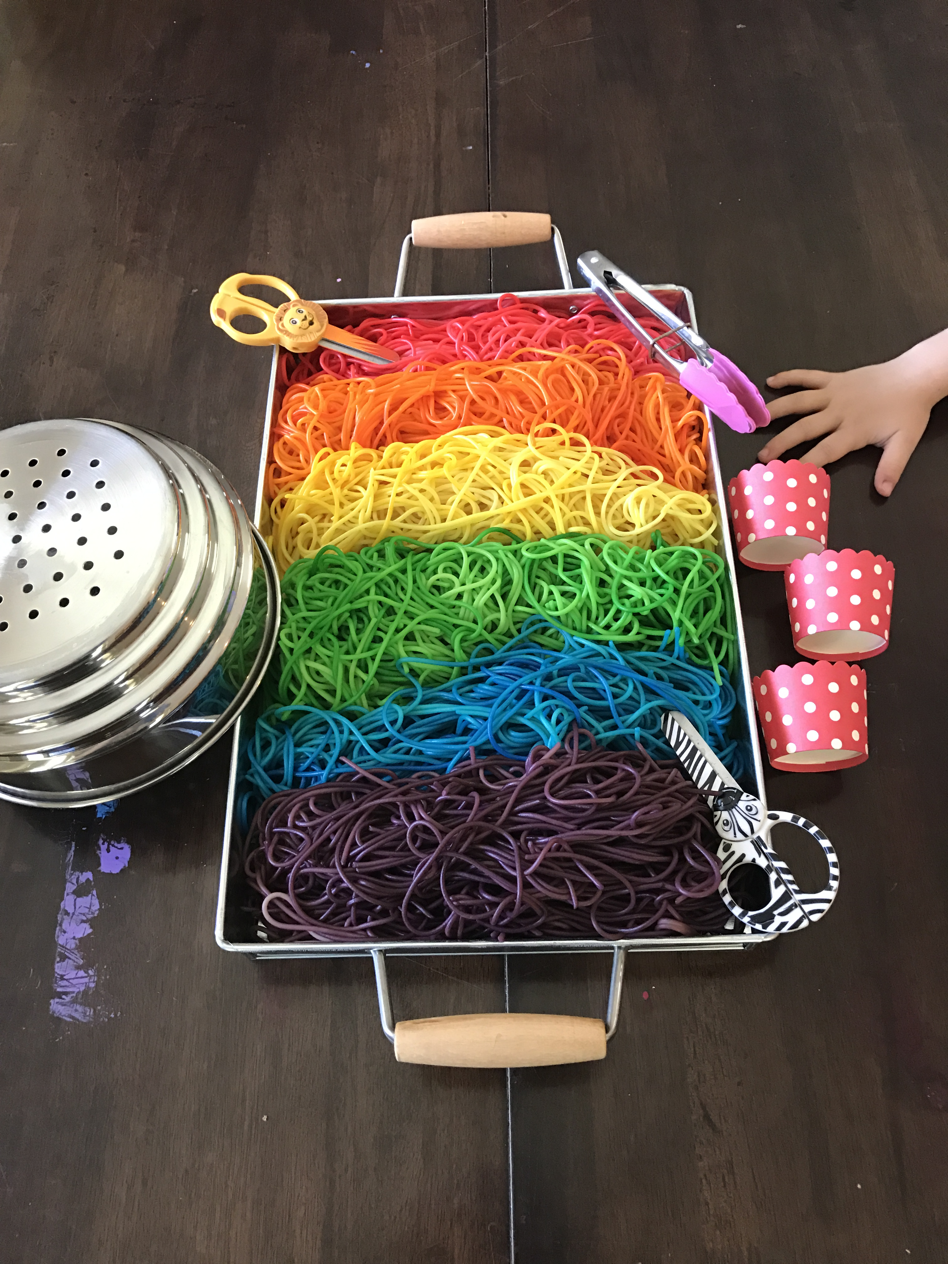 rainbow spaghetti sensory tub