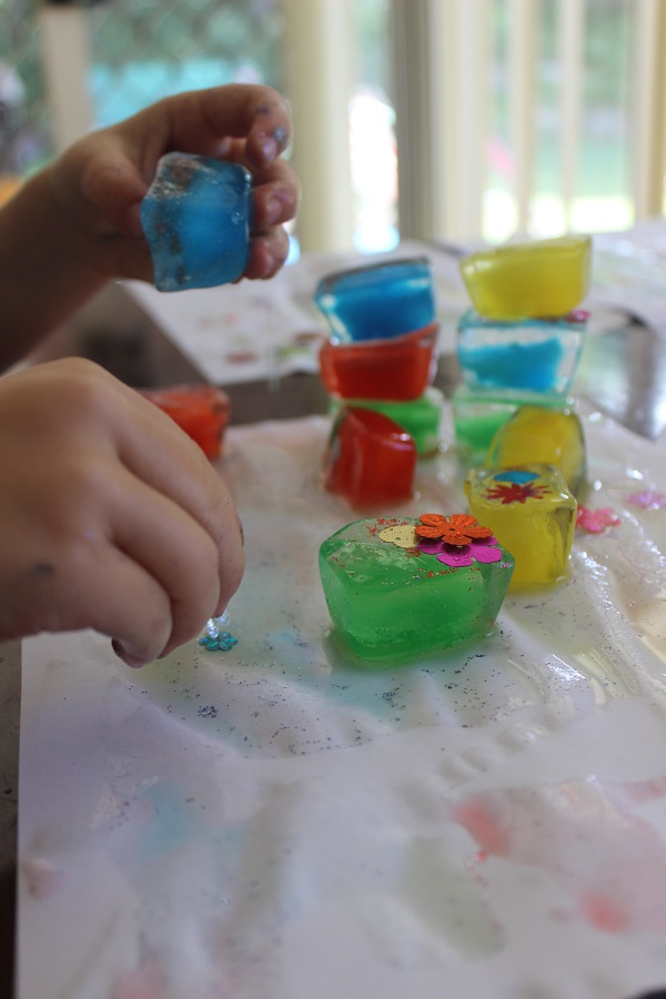 Ice cube painting the results of sensory play with Finlee and Me