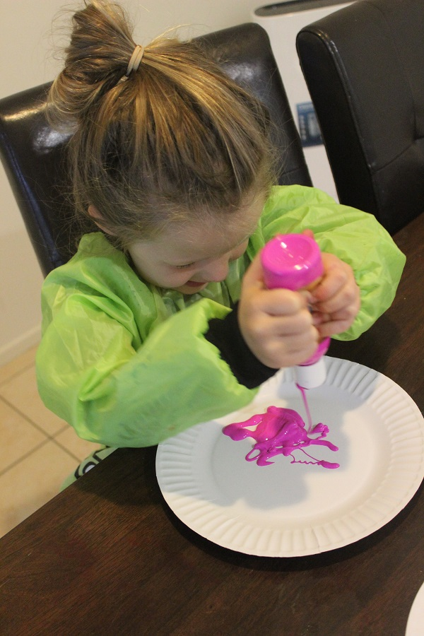 Balloon splatter painting craft activity with Finlee and Me